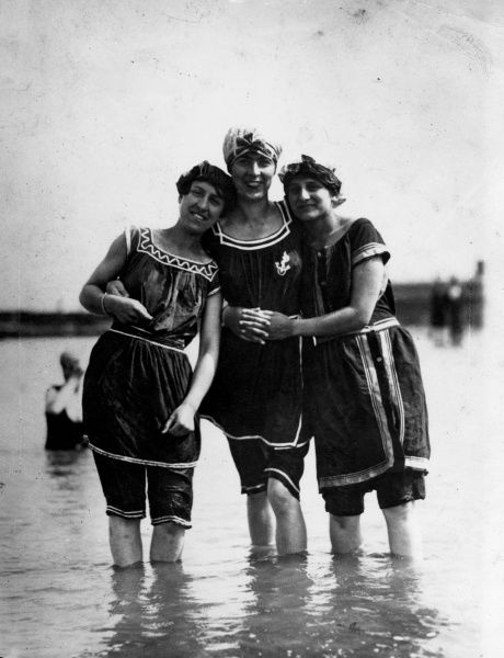 Three 'Bathing Belles' in natty swimming costumes, braving the cold waters of a British seaside resort! Date: 1910s