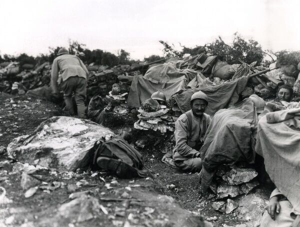 Scene in a Serbian Front trench during the Battle of Kajmakchalan between Bulgarian and Serbian troops on the Macedonian Front, First World War. These hills are very rocky, making the digging of deep trenches impossible. Date: September 1916