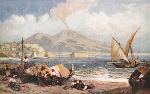 On the shores of the Mediterranean, a view of Naples from Mergellina harbour with fishing boats in the foreground and Vesuvius smouldering in the distance