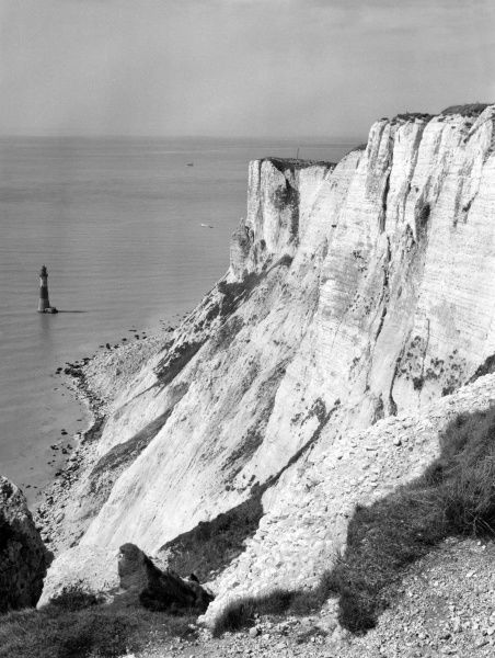 The dramatic chalk headland of Beachy Head, Sussex, England and its Lighthouse. Date: built 1902