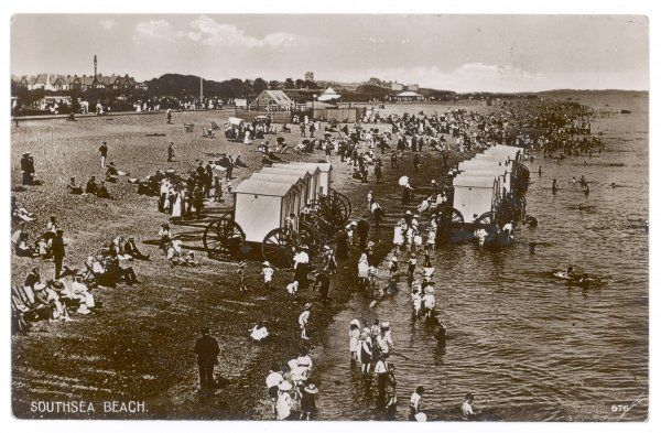 Ar Southsea, Hampshire, some of the bathing machines have been taken into the water so that bathers can enter the sea directly : most people simply want to paddle, though