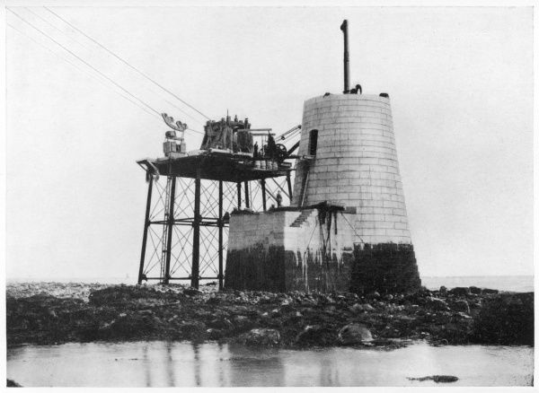 Building Beachy Head Lighthouse. 43 metres in height (31 metres above water). Brought into service in 1902