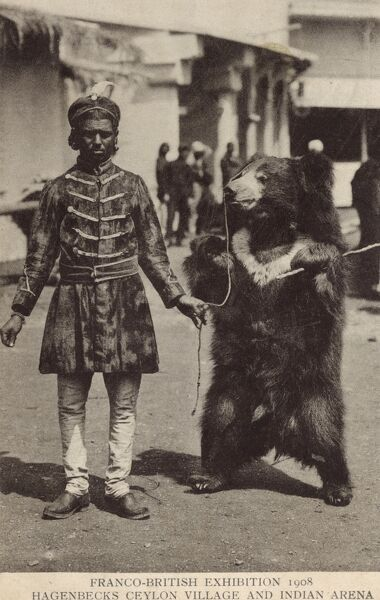 A bear handler and his bear at the Franco-British Exhibition of 1908 at White City, London - at the Hagenbecks Ceylon Village and Indian Arena Date: 1908