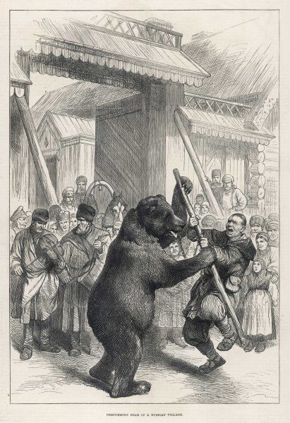 A bear and its trainer engage in a mock combat to entertain the residents of a Russian village