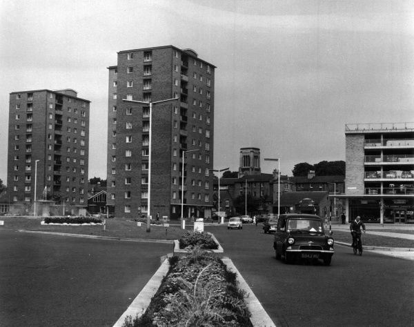 A road in the outskirts of Bedford showing modern blocks of flats. Date: 1964