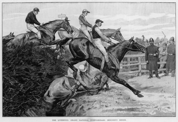 A horse and his rider take a tumble at the infamous Beecher's Brook on the Grand National course at Aintree