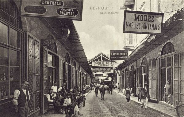 Beirut, Lebanon - Souk-et-Gamil - with clothes stalls and shops and at the end the premices of the producers of this card! Date: circa 1910s