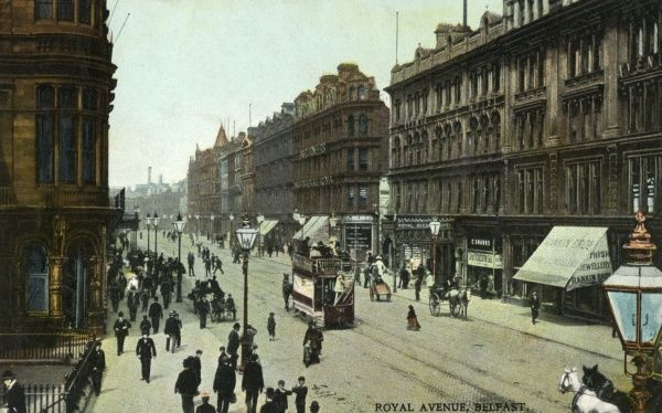 Electric tram and horse-drawn vehicles in Royal Avenue. Date: circa 1905