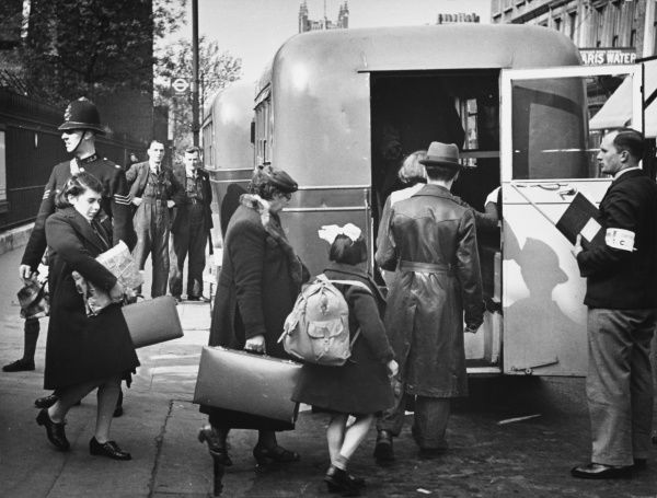Belgian refugees entering the bus that is to take them to the distributing centre during World War II in London