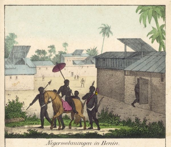 Village scene in Benin - a high-ranking citizen with his attendants
