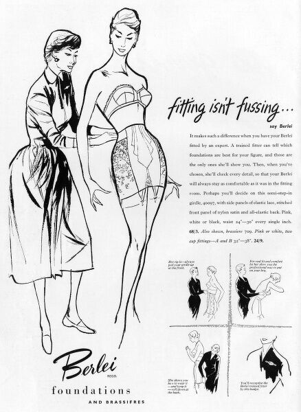 A slender lady with an hourglass figure is fitted for some rather constricting looking foundation garments by a Berlei expert in an advertisement for the brand. Date: 1953