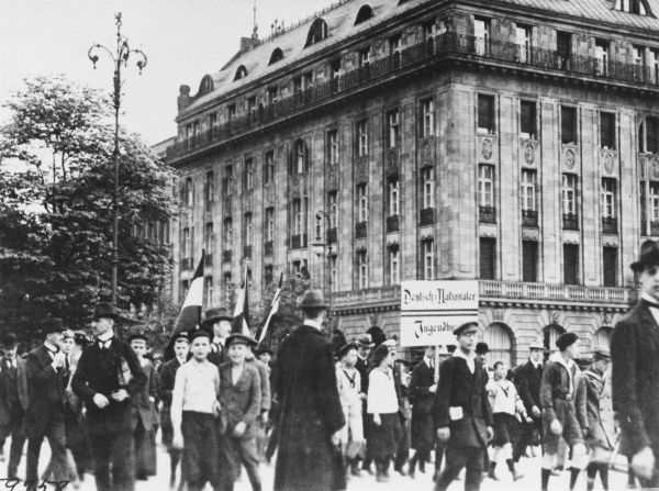 Demonstration against the terms of peace in Berlin, Germany. Crowds passing the Hotel Adlon where Allied Missions are staying on 14th May 1919