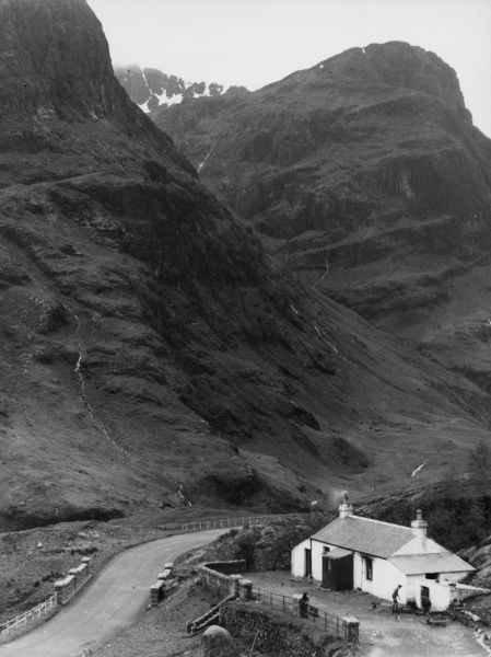 The great peaks of Bidean nam Bian, towering above the new road through Glencoe, Argyllshire, Scotland. Date: 1950s