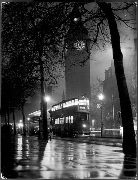 A wet evening at the Westminster Bridge end of the Victoria Embankment, with Big Ben showing the light which indicates that Parliament is sitting. Note also the tram