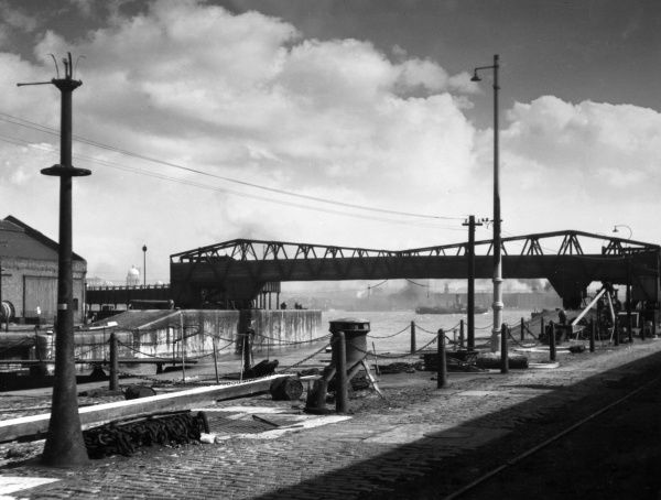 This bridge at Birkenhead Dock, Merseyside, England, was at one time used for transporting cattle only. Date: 1950s