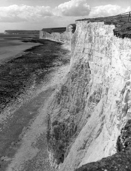 A fine impression of the chalk cliffs at Birling Gap, on the Sussex coast, near Beachy Head, England. Date: 1960s