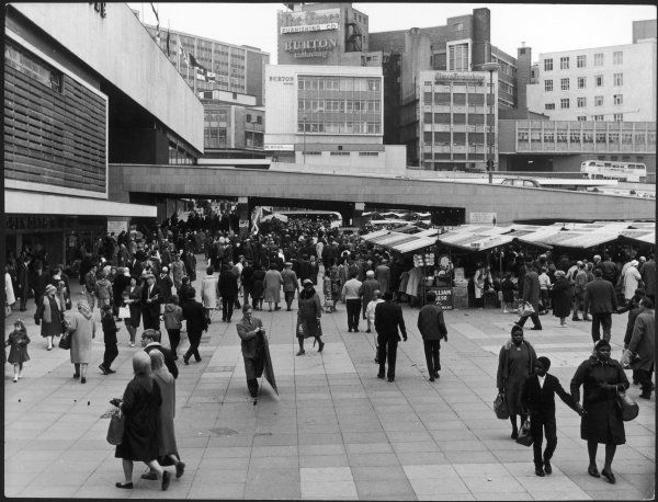 A busy scene in the shopping area of the Bull Ring complex, Birmingham, England
