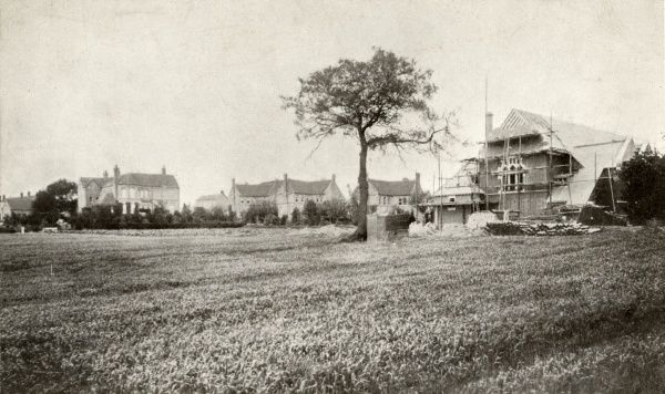 View of the cottage homes and chapel under construction at Marston Green in Warwickshire, to the east of Birmingham. The homes were opened by the Birmingham Poor Law Authorities in 1879 to house over 400 pauper children away from the workhouse