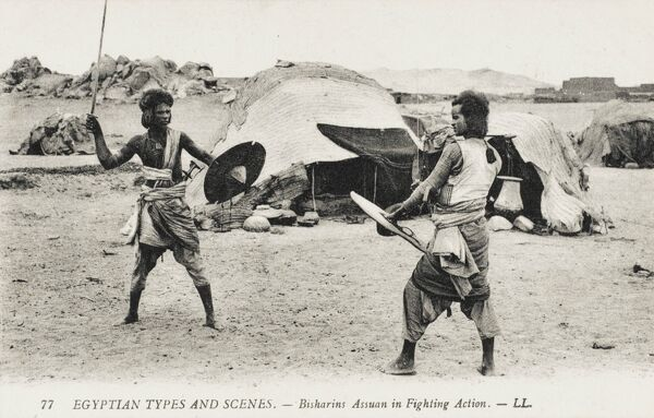 Bisharin Tribesmen of Aswan with traditional weapons having a fencing match