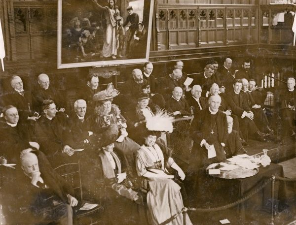 The Bishop of London giving a speech in aid of a waifs and strays charity (probably The Waifs and Strays' Society, now The Childrens' Society) at Church House, Westminster, Central London. Princess Schleswig-Holstein is seated on his right