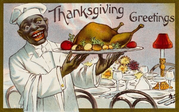 A jovial black waiter in America raises aloft the Thanksgiving Turkey on this Greetings card