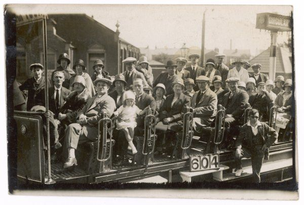 A party of Blackpool (Lancashire) holidaymakers do the circular tour of the town in an open tramway car
