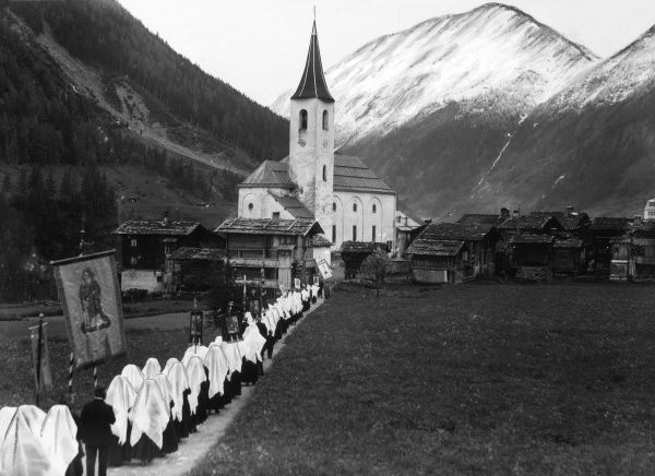 Blessing a new chapel in the village of Appenzell Canton, Switzerland. Our picture shows the clergy in their 18th century costumes, with a police escort. Date: 1930s