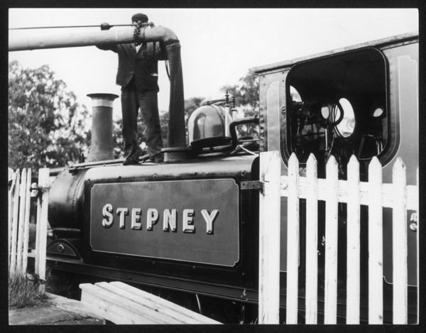 The locomotive 'Stepney' taking on water at the Bluebell Railway, Sheffield Park, Sussex, England
