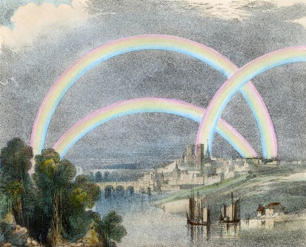 Three rainbows over a river with a bridge in the background and ships in the foreground