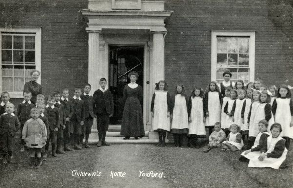Children and staff stand in front of the Blything Union children's home at Yoxford, Suffolk. The home, opened in the early 1900s, accommodated pauper children away from the workhouse
