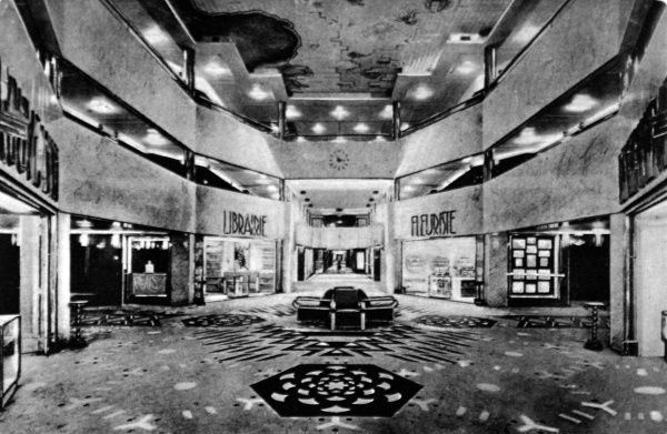 On board the French luxury liner, L' Atlantique. A unusual feature at the time, the central 'street' of shops, over 150 meters long, with the spacious embarkation hall. Fire broke out on the L' Alantiique in the early hours of 4th January 1933