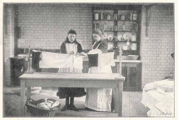A board school girl learns the domestic arts that will prepare her for housewifery. Here she is given a lesson in drying clothes