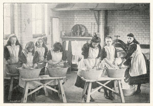 Girls at a board school are taught the domestic arts such as washing