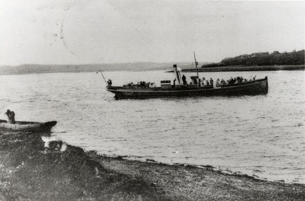 A long passenger boat off the coast at Llangwm, near Haverfordwest, Pembrokeshire, Dyfed, South Wales. The village is located on the western bank of the Cleddau Estuary, and had a strong fishing industry for many years