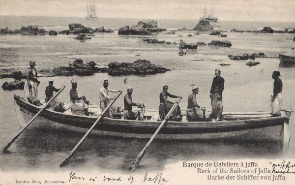 Boatmen of Jaffa in their barque, Israel (then under Ottoman control) - the boatmen used to ferry visitors from larger ships into the port in these craft. Date: circa 1903