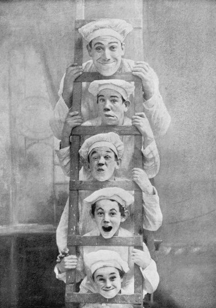 The Boganny Troupe, otherwise known as 'The Lunatic Bakers'. The five members rest their chins on the rungs of a ladder and pull faces for the camera