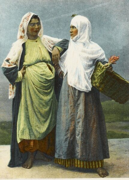 Two Bohemian Peasant Women, one heavily pregnant, in conversation in Constantinople,. The lady on the right is a flower seller
