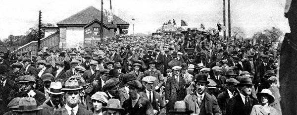Photograph of thousands of football fans heading for Wembley Stadium before the start of the 1923 F.A. Cup Final between Bolton Wanderers and West Ham United