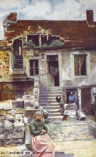The two elderly female occupants of a heavily-damaged house in Northern France during the First World War, who resolutely refused to leave their battered home. Date: 1919