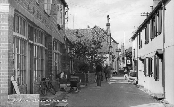The high street - Bosham, West, Sussex - a view of this charming coastal village, the site of King Canute's aborted attempt to hold back the tide