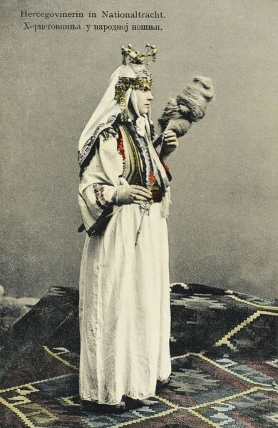 Sarajevo, Bosnia and Herzegovina - Woman hand spinning wool in the National Costume