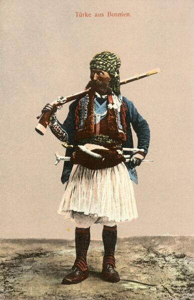 Bosnian Bandit in traditional regional costume armed to the back teeth... Date: circa 1910