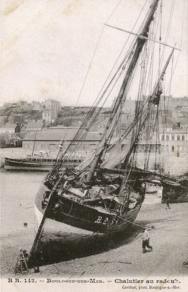 Boulogne-sur-Mer, France - Trawler at low tide Date: circa 1903