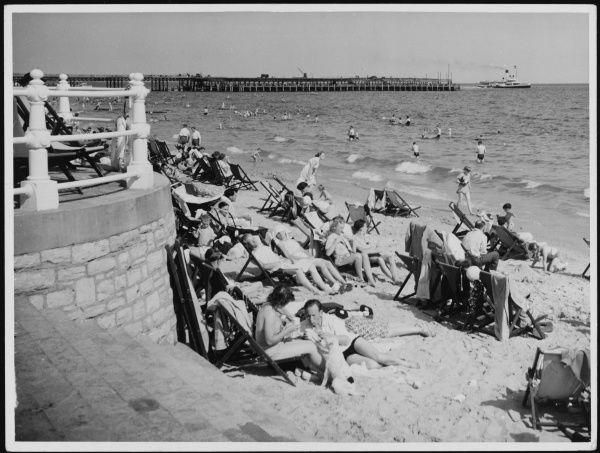 Holidaymakers on the beach at Bournemouth, Dorset, England, at the height of the holiday season