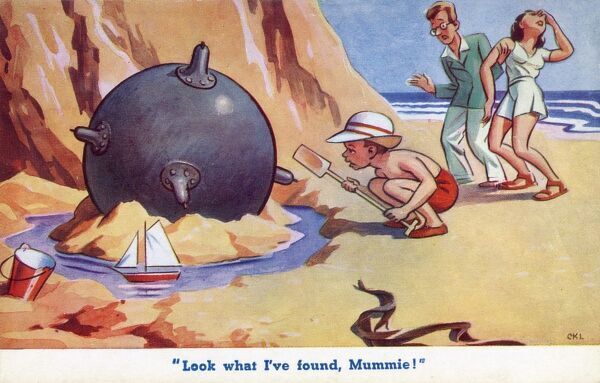 """Look what I've found Mummie!"" A small boy discovers a mine on the beach whilst making a sandcastle. His Mother is fainting in shock at this explosive discovery. Date: 1940s"