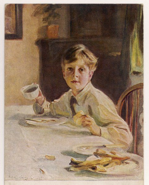 A young boy at breakfast