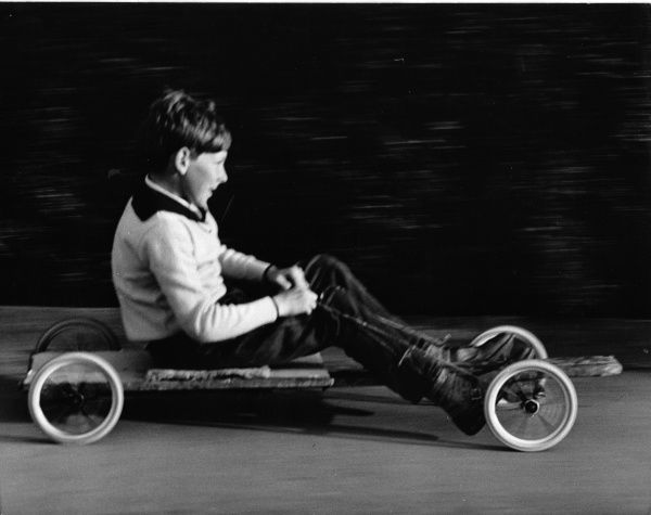 A boy goes for a ride on a home-made go-kart in Horley, Surrey