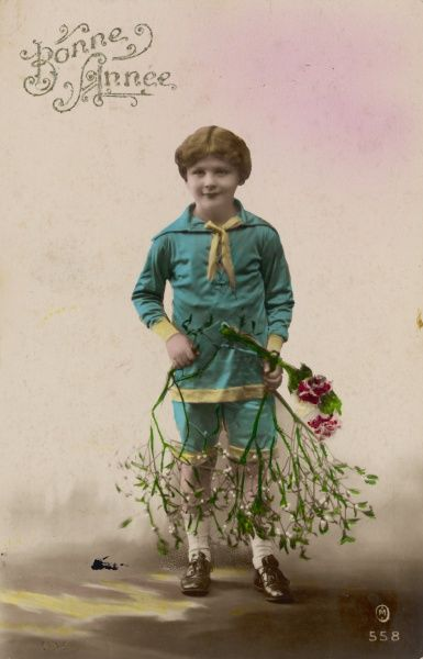 A French boy with a bough of mistletoe to wish you 'Bonne Annee !&#39