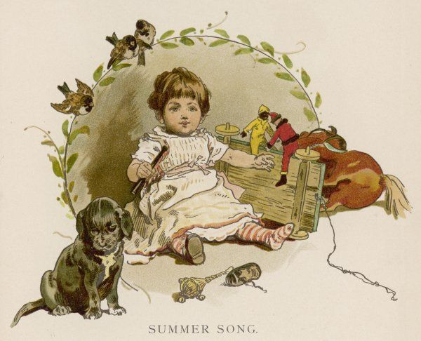 A young boy with toys - including a rattle - and a puppy