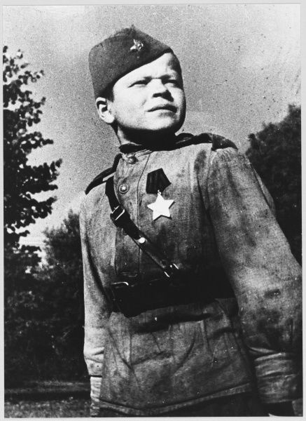 A proud Soviet boy soldier decorated with the 'Order of Glory' - probably a member of a reconnaissance unit
